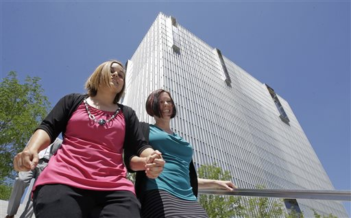 Angie, left, and Kami Roe of West Jordan leave the federal courthouse Wednesday, July 15, 2015, in Salt Lake City. A federal judge has ordered the state of Utah to list the names of the lesbian couple on a birth certificate as the mothers of their new baby. U.S. District Judge Dee Benson said Wednesday the case wasn't hard to decide in the wake of the U.S. Supreme Court ruling legalizing same-sex marriage, Salt Lake City, July 15, 2015 | AP Photo by Rick Bowmer, St. George News