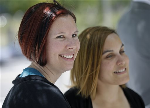 Angie, right, and Kami Roe of West Jordan, leave the federal courthouse Wednesday, July 15, 2015, in Salt Lake City. A federal judge has ordered the state of Utah to list the names of the lesbian couple on a birth certificate as the mothers of their new baby. U.S. District Judge Dee Benson said Wednesday the case wasn't hard to decide in the wake of the U.S. Supreme Court ruling legalizing same-sex marriage, Salt Lake City, July 14, 2015   AP Photo by Rick Bowmer, St. George News