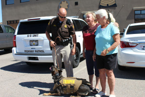 UHP Trooper Chris Terry and K-9 Titan meet Margaret Manazer (far right), who donated a stab and bulletproof vest for Titan with help from Kris Neal, a member of the Vest Dixie's K9's fundraiser, Hurricane, Utah, July 25, 2015 | Photo by Nataly Burdick, St. George News