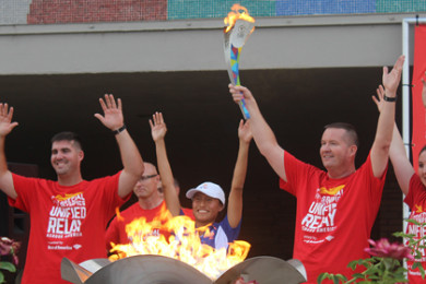 Jazmine Slama and other torchbearers celebrate the lighting of the Flame of Hope at Dixie State University, St. George, Utah, July 3, 2015 | Photo by Nataly Burdick, St. George News