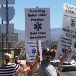 Unionized workers and their families gather at St. George Boulevard and River Road to protect alleged unfair labor practices on the part of Gold Cross Ambulances, St. George, Utah, July 25, 2015 | Photo by Mori Kessler, St. George News