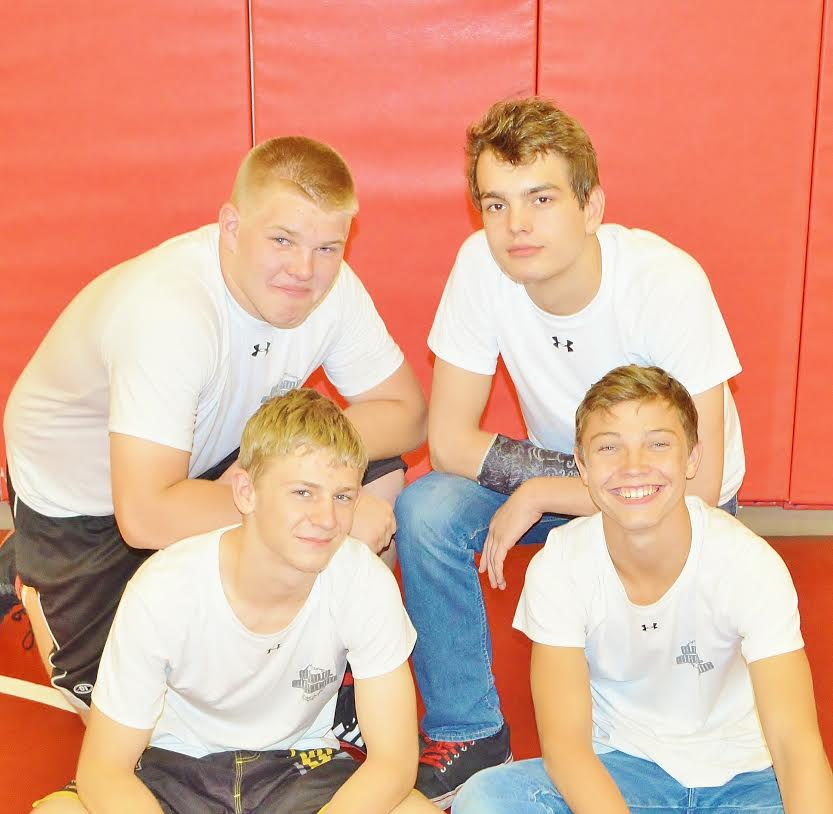 Hurricane Valley wrestlers who qualified for Team Utah are (clockwise, from top left) Matthew Lemmon, Devin English, Treyson Abbott and Jayden Griffin.   Photo courtesy Cortney English.