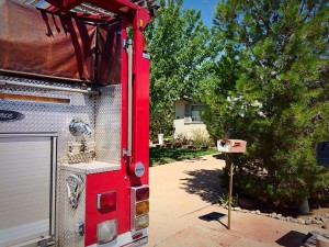 A woman was transported to the hospital after becoming stuck underneath her home and rescued by firefighters in the area of 1900 West and 1500 North, St. George, Utah, July 21, 2015 | Photo by Kimberly Scott, St. George News