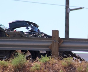 A Mustang sits wrecked on the shoulder of Interstate 15, Washington, Utah, August 13, 2015 | Photo by Ric Wayman, St. George News