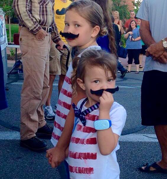"""Young contestants participate in the Mustache Contest at """"George, Streetfest on Main."""" St. George, Utah, Aug. 7, 2015 