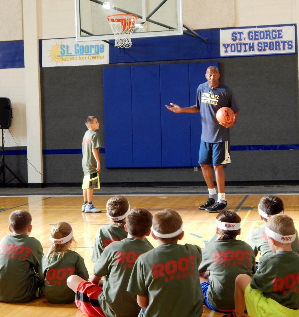 KJZZ TV personality and former NBA star Thurl Bailey speaks to youth at the Utah Jazz promotional event Monday evening at the St. George Recreation Center, St. George, Utah, Aug. 17, 2015. | Photo by Shelly Griffin, St. George News