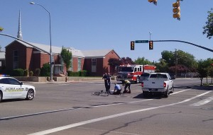 A bicyclist was injured Friday after he ran a red light and was clipped by a car, St. George, Utah, Aug. 28, 2015 | Photo courtesy of Amy Palmer, St. George News
