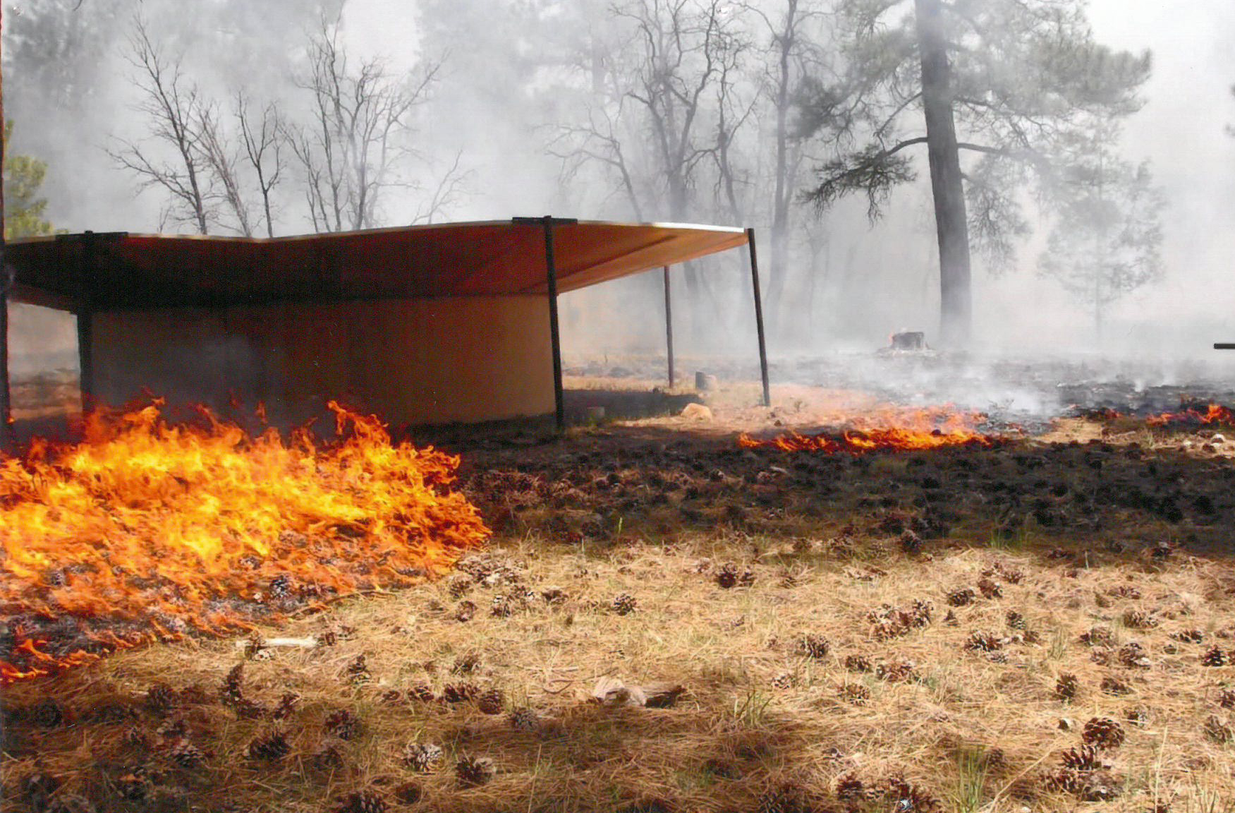 A trick tank located on the Tusayan Ranger District, Kaibab National Forest during a managed wildfire in 2008. Nearly 40 trick tanks are located throughout the Kaibab to provide wildlife such as elk, deer and turkey water. (Credit of the U.S. Forest Service, Southwestern Region, Kaibab National Forest).