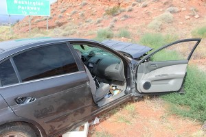A single-car accident on I-15 sent a local man to the hospital with moderate injuries, Washington, Utah, August 1, 2015 | Photo by Ric Wayman, St. George News