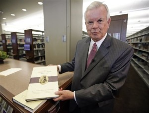 The Church of Jesus Christ of Latter-day Saints historian Steven E. Snow displays the third volume of the Joseph Smith Papers, which includes the printer's manuscript of the Book of Mormon, during a news conference, Salt Lake City, Utah, Aug. 4, 2015 | AP Photo by Rick Bowmer, St. George News