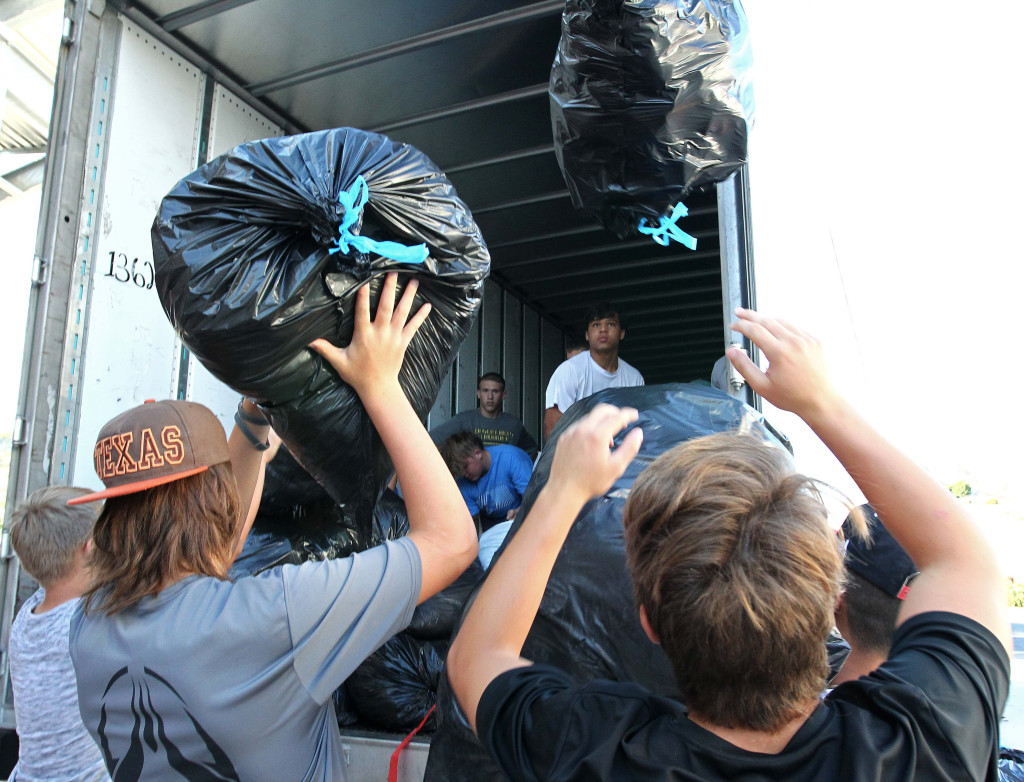 Players from your Desert Hills Football team load bags involving donated clothes in to be able to a semi-truck to be taken towards the I Won't Cheat Foundation, Desert Hills Football Charity Fundraiser, St. George News<br><br>Franke said he sees the great deal of charity work all through the region through football teams as well as schools.<br><br><img width