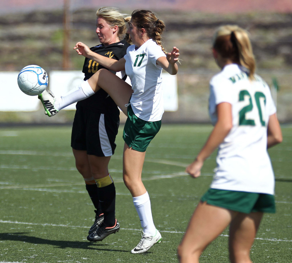 Emily Hafen (17) fights for a loose ball for Snow Canyon, Snow Canyon vs. Mountain View, Girls Soccer, St. George, Utah, Aug. 15, 2015, | Photo by Robert Hoppie, ASPpix.com, St. George News
