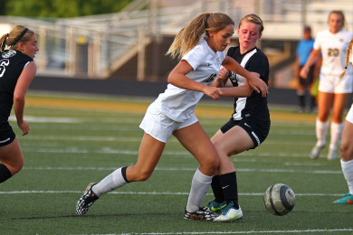 Desert Hills' Kenzie Done fights for a loose ball, Desert Hills vs. Syracuse, Girls Soccer, St. George, Utah, Aug. 19, 2015, | Photo by Robert Hoppie, ASPpix.com, St. George News
