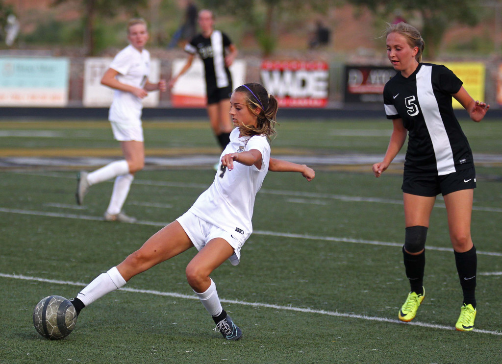 Hadley Cowan (4) reaches for a ball, Desert Hills vs. Syracuse, Girls Soccer, St. George, Utah, Aug. 19, 2015, | Photo by Robert Hoppie, ASPpix.com, St. George News