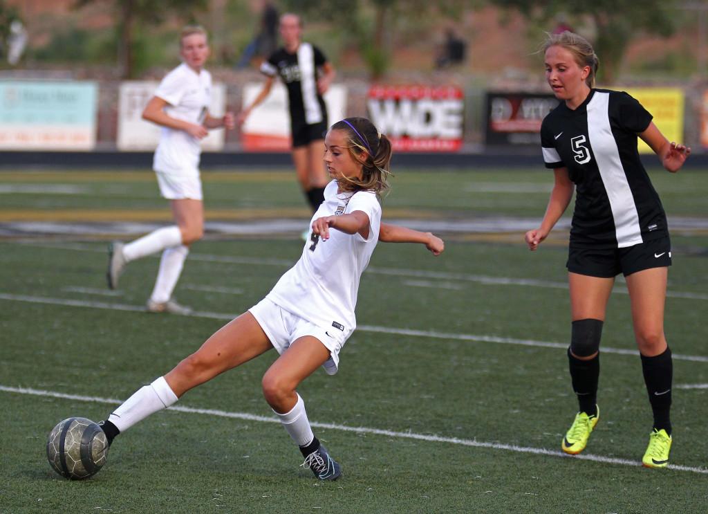 Hadley Cowan (4) reaches for a ball, Desert Hills vs. Syracuse, Girls Soccer, St. George, Utah, Aug. 19, 2015, | Photo by Robert Hoppie, ASPpix.com, St. George News