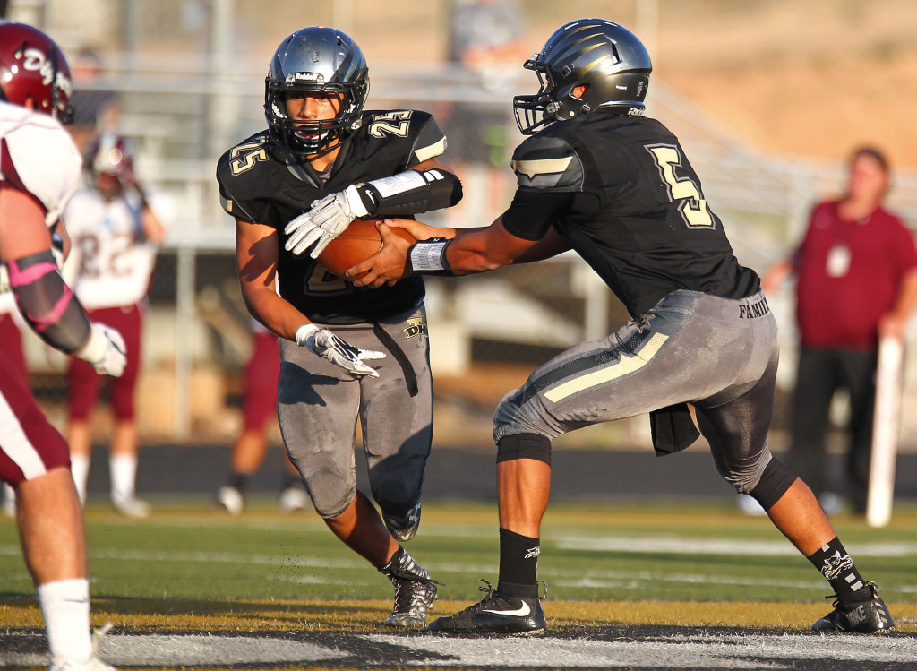 Thunder quarterback Nick Warmsley (5) hands off to running back Marco Jordan (25), Desert Hills vs. Jordan, Football, St. George, Utah, Aug. 21, 2015, | Photo by Robert Hoppie, ASPpix.com, St. George News