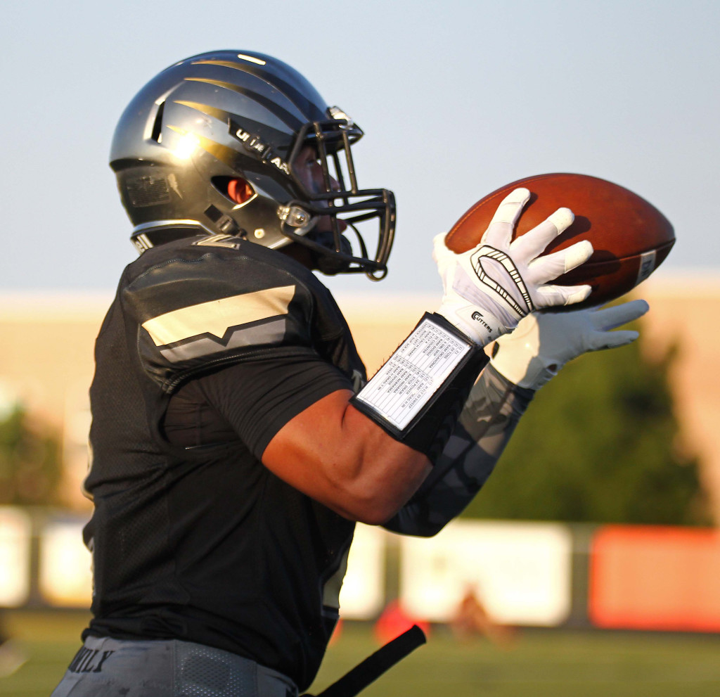 Stetson Wood makes a catch and heads to the end zone for a Desert Hills touchdown, Desert Hills vs. Jordan, Football, St. George, Utah, Aug. 21, 2015, | Photo by Robert Hoppie, ASPpix.com, St. George News