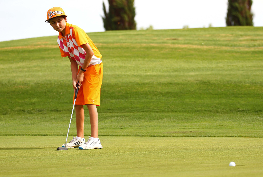Cruz Kirchhausen watches his putt fall,  JAG Junior Golf Tournament, St. George, Utah, Aug. 1, 2015,   Photo by Robert Hoppie, ASPpix.com, St. George News