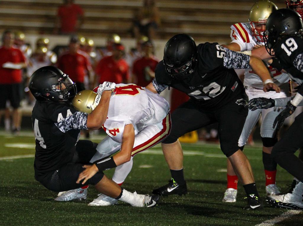 Dillan Robertson (44) sacks the Judge quarterback, Pine View vs. Judge Memorial, Football, St. George, Utah, Aug. 21, 2015, | Photo by Robert Hoppie, ASPpix.com, St. George News
