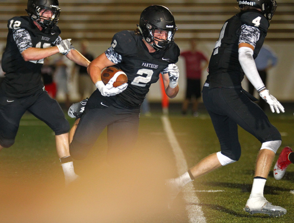 Panther running back Kobe Topalian (2) turns the corner and heads for the game winning touchdown in the second overtime, Pine View vs. Judge Memorial, Football, St. George, Utah, Aug. 21, 2015, | Photo by Robert Hoppie, ASPpix.com, St. George News