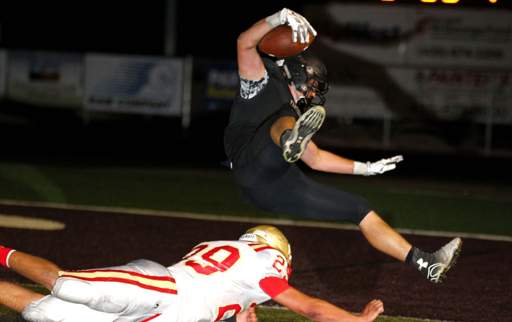 Pine View running back Kobe Topalian dives in to the Panther end zone for the game winning score in double over time, Pine View vs. Judge Memorial, Football, St. George, Utah, Aug. 21, 2015, | Photo by Robert Hoppie, ASPpix.com, St. George News