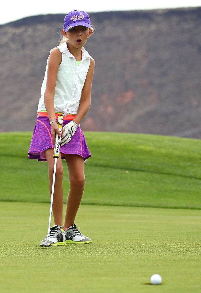 Ellie Johnson watches her putt on the 5th green at Sunbrook, JAG Junior Golf Tournament, St. George, Utah, Aug. 1, 2015,   Photo by Robert Hoppie, ASPpix.com, St. George News