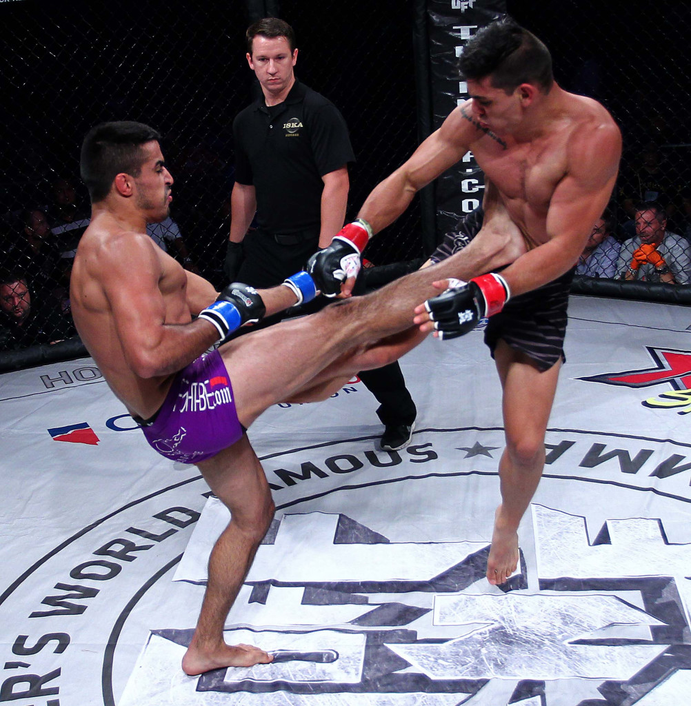 Rocky Cantu (purple shorts) vs. Hugo Flores (black shorts),Mayhem in Mesquite VII Mixed Martial Arts event at the CasaBlanca, Mesquite, Nevada, Aug. 22, 2015, | Photo by Robert Hoppie, ASPpix.com, St. George News