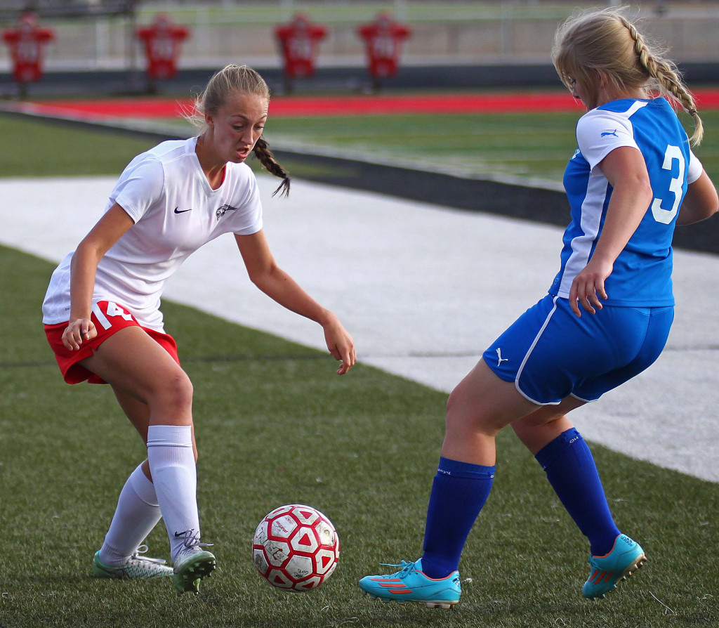 Kenzie Beardall (14) fights for a loose ball for the Tigers, Hurricane vs. Beaver, Girls Soccer, St. George, Utah, Aug. 27, 2015, | Photo by Robert Hoppie, ASPpix.com, St. George News