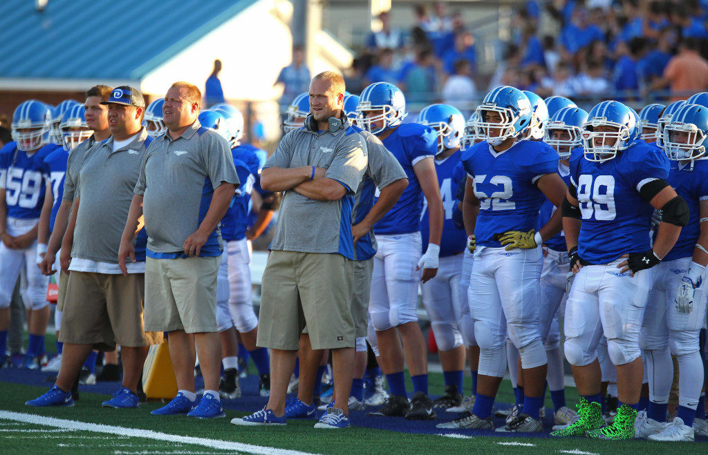 Dixie coaches Andy Stokes (center) and Brent Nyberg, Dixie vs. Mohave Ariz. Football, St. George, Utah, Aug. 28, 2015, | Photo by Robert Hoppie, ASPpix.com, St. George News