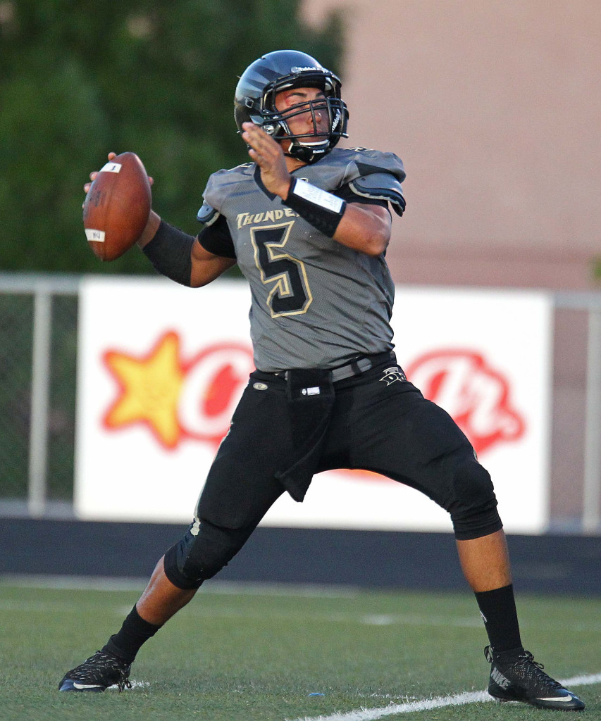 Desert Hills quarterback Nick Warmly (5) makes a throw, Desert Hills vs. Foothill Nev., Football, St. George, Utah, Aug. 28, 2015, | Photo by Robert Hoppie, ASPpix.com, St. George News