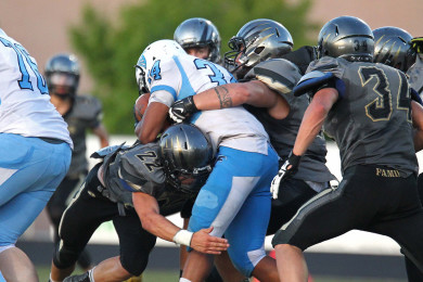 The Thunder defense clamps down on a Foothill ball carrier, Desert Hills vs. Foothill Nev., Football, St. George, Utah, Aug. 28, 2015, | Photo by Robert Hoppie, ASPpix.com, St. George News