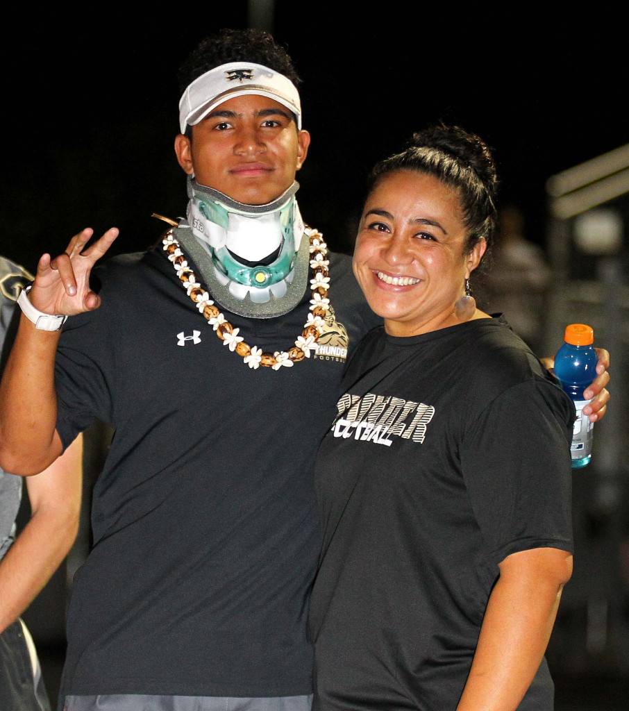 Nephi Sewell (with his mother on the Desert Hills sideline) got the all-clear message from doctors a year after a scary neck injury. File photo from Desert Hills vs. Foothill Nev., Football, St. George, Utah, Aug. 28, 2015, | Photo by Robert Hoppie, ASPpix.com, St. George News