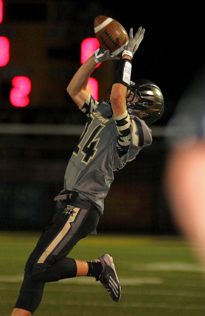Logan Hokanson (24) makes a catch for the Thunder, Desert Hills vs. Foothill Nev., Football, St. George, Utah, Aug. 28, 2015, | Photo by Robert Hoppie, ASPpix.com, St. George News