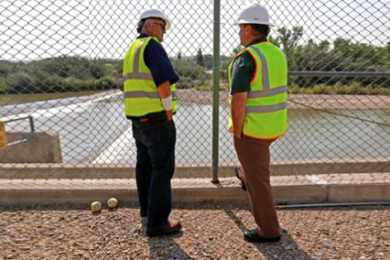 Bob Fredriksen, left, CH2M water operations manager, and David Sypher, public works director, look at the water pumping, Thursday, at the Animas Pump Station No. 2 in Flora Vista, N.M. The quality of San Juan River water on the Navajo Nation has returned to what it was before a spill at a Colorado gold mine sent toxic sludge into the waterway, federal officials said Thursday. Flora Vista, New Mexico, Aug. 20, 2015   Photo by Alexa Rogals/The Daily Times via AP; St. George News   Photo altered / stretched at left and right sides