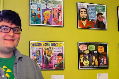 Zak Mitchell stands with his artwork on display at Main Street Books, date unspecified   Photo courtesy of the Cedar City Arts Council, St. George News