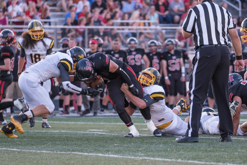 Jake Carr stretches for more yardage, Union at Hurricane, Hurricane, Utah, Aug. 28, 2015 | Photo by Dave Amodt, St. George News