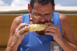 Gobbling up the corn during the corn eating contest at the Enterprise Cornfest, Enterprise, Utah, August 29, 2015 | Photo by Hollie Reina, St. George News