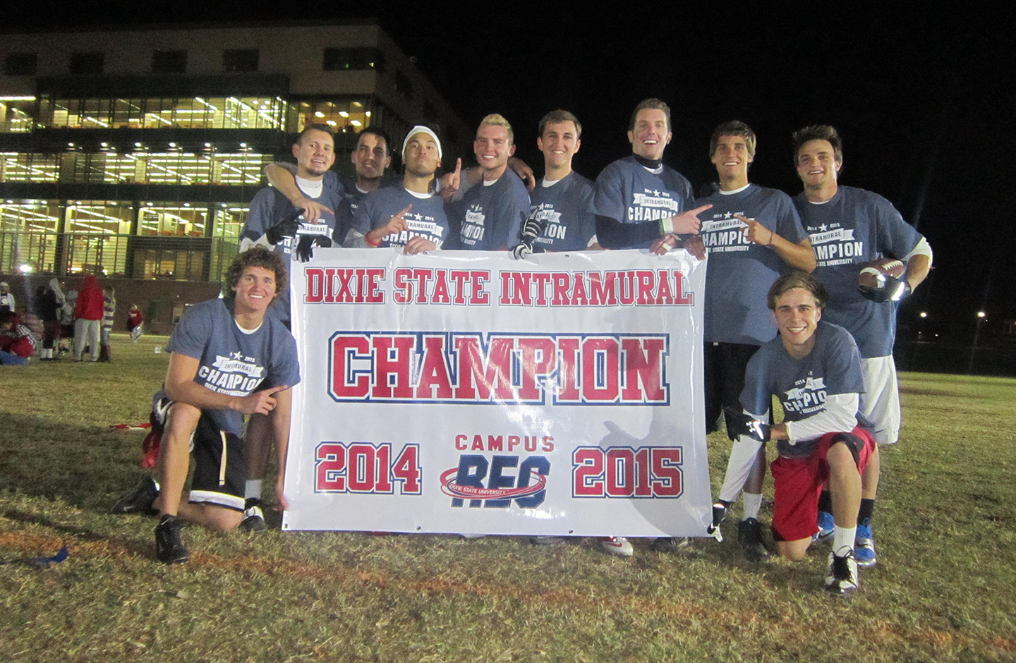 Students on the team Outta Control celebrate winning the 2014-15 Dixie State University intramural flag football championship. Photo taken on the field  field right by the Holland Centennial Commons building, Dixie State University campus, St. George, Utah, Nov. 4, 2015 | Photo courtesy of Dixie State University, St. George News