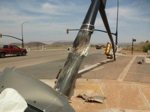 A man was transported to the hospital after falling asleep and crashing his car into a traffic signal pole at 2260 West State Street, causing it to fall over, Hurricane, Utah, Aug. 19, 2015 | Photo courtesy of the Hurricane City Police Department, St. George News