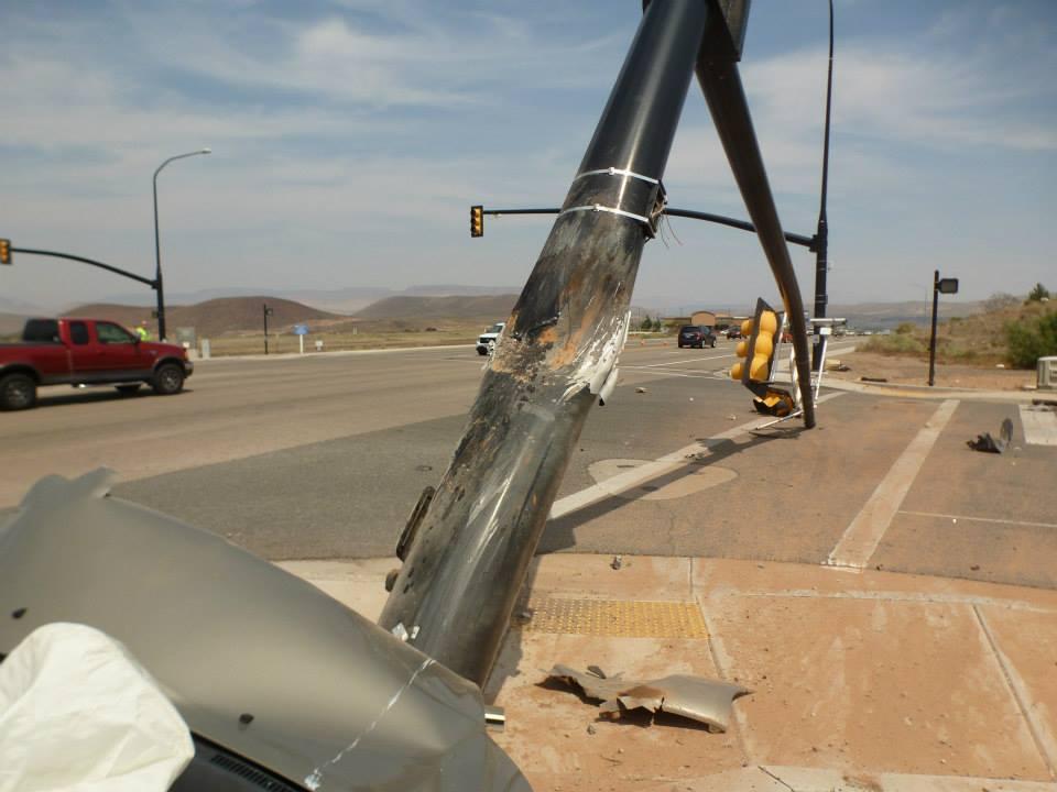 Driver Falls Asleep Launches Car Into Traffic Signal Pole