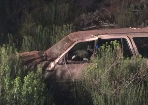 Suspected drunk driver lands at the bottom of a 20- to 30-foot embankment on the east side of state Route 14, Cedar City, Utah, Aug. 18, 2015 | Photo by Carin Miller, St. George News