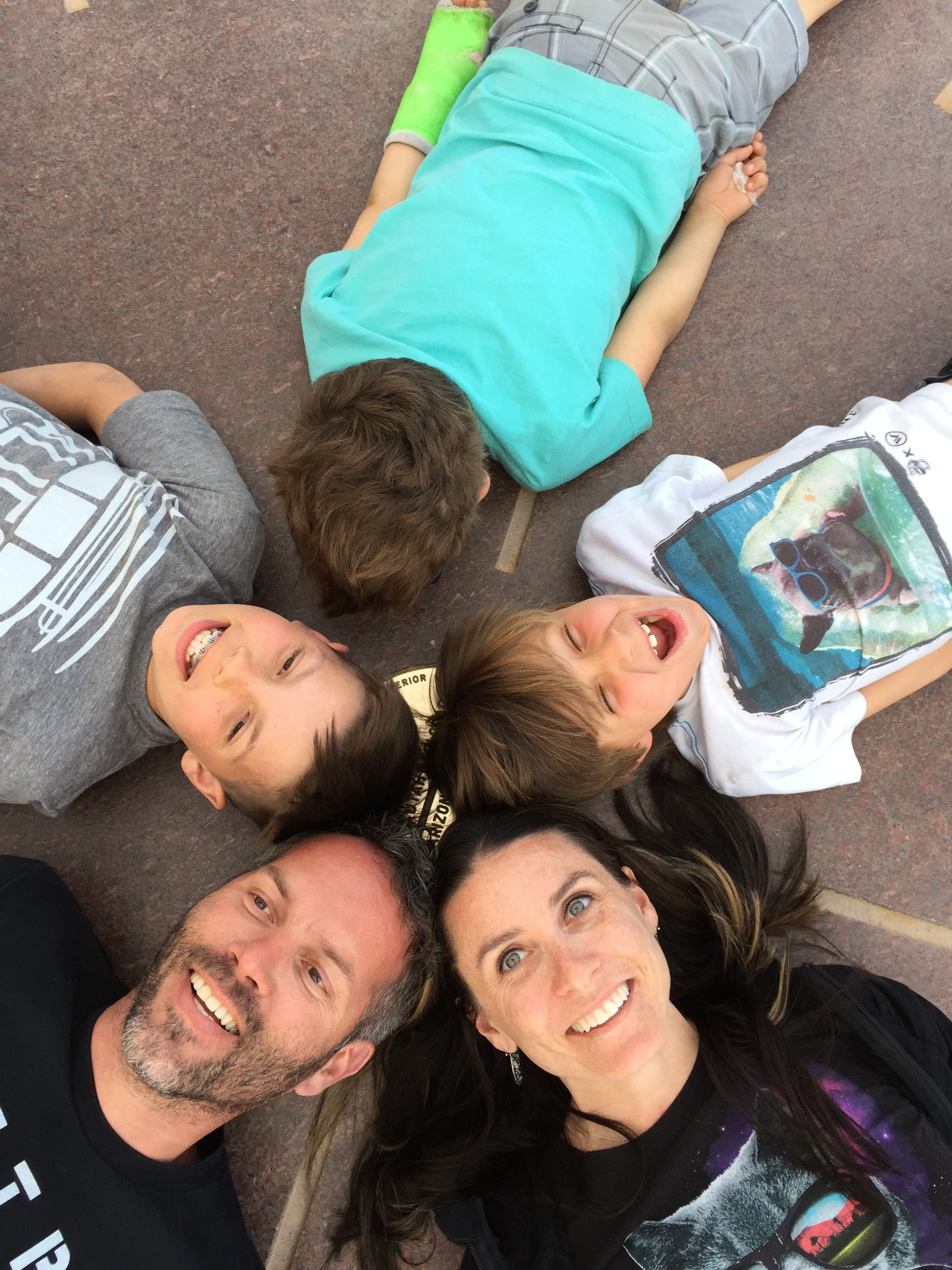 """The Dayton family poses for an official and brief """"Four Corners"""" photo.  One boy wouldn't face up because he didn't get to be in the state of his choosing.  Four Corners Monument, Arizona, Colorado, New Mexico and Utah, April 2015 