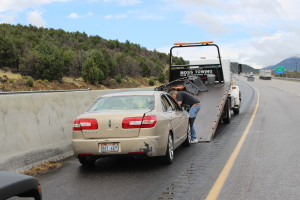 Standing water on Interstate 15 near milepost 33 causes Lincoln Zephyr to spin out of control and hit the cement barrier. Washington County, Utah, Aug. 7, 2015 | Photo by Jessica Tempfer, St. George News