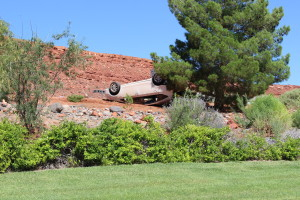 One vehicle rolls and another flips after a Dodge truck collides with a Toyota hybrid on Snow Canyon Parkway, St. George, Utah, Aug. 8, 2015 | Photo by Jessica Tempfer, St. George News