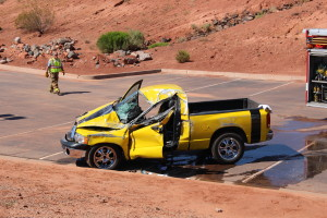 Two vehicles rolled after a Dodge truck collided with a Toyota Hybrid. St. George, Utah, Aug. 8, 2015 | Photo by Jessica Tempfer