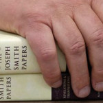 The Church of Jesus Christ of Latter-day Saints historian Steven E. Snow rests his hand on the third volume of the Joseph Smith papers, which includes the printer's manuscript of the Book of Mormon, during a news conference, Salt Lake City, Utah, Aug. 4, 2015   AP Photo by Rick Bowmer, St. George News