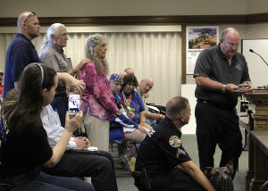 Cedar City Police Chief Bob Allinson awards Dennis and June Schnarr with a challenge coin,  Cedar City Council Chambers, Cedar City, Utah, August 12, 2015 | Photo by Carin Miller, St. George News