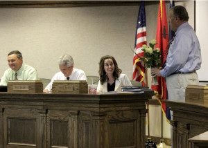 Councilman Don Marchant presents Mayor Maile Wilson with happy birthday roses, Cedar City Council Chambers, Cedar City, Utah, August 20, 2015 | Photo by Carin Miller, St. George News