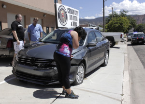 A silver Dodge Intrepid swerved for unknown reasons, crossing their lane and running up the curb into a parked car, the area of 700 West and 400 North, Cedar City, Utah, August 27, 2015 | Photo by Carin Miller, St. George News