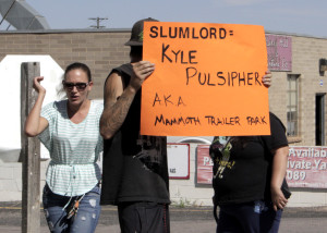 "Residents gather in protest of what they call ""slum lord"" living conditions, Mammoth Mobile Estates, Cedar City, Utah, August 28, 2015 